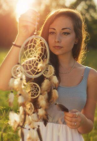 eye catcher: Beautiful ladies holding Dream Catcher Stock Photo