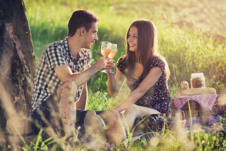 rose wine: Attractive couple at countryside