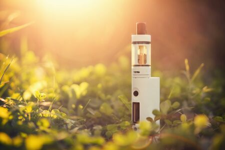 non  smoking: Adjustable electronic cigarette, carcinogenic alternative for Non smoking, sunset in the background,