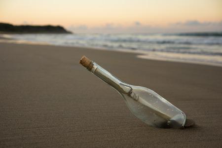 ocean sunset: message in the bottle