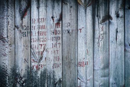 cyrillic: Old vintage wood wall, worn with Cyrillic text unreadable