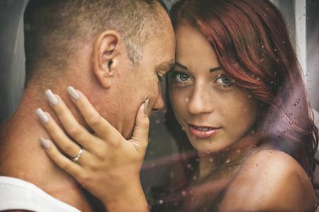 Lovers in the window Standard-Bild