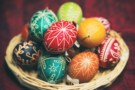 Vintage style photo from decorated Easter eggs in the basket with traditional patterns hungarian