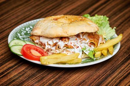 sandwich de pollo: Gyros, greek sandwich wrapped with similar Turkish doner kebab
