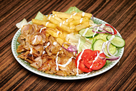 Gyros, greek sandwich wrapped with similar Turkish doner kebab