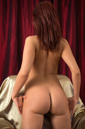 Naked Lady with beautiful ass.