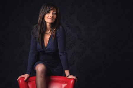 Beautiful middle aged woman in elegant room Archivio Fotografico