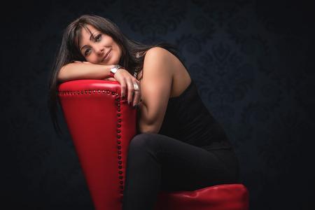 Beautiful middle aged woman in elegant room Standard-Bild