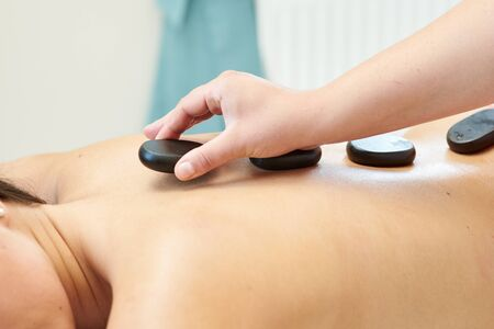 Woman getting spa treatment with lava stones