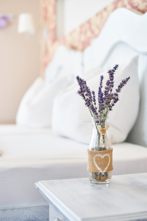 Vintage decor vase in a bright bedroom