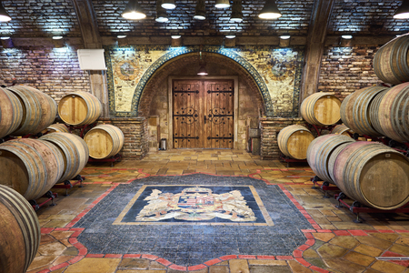 Wine cellar with Hungarian crest on the floor