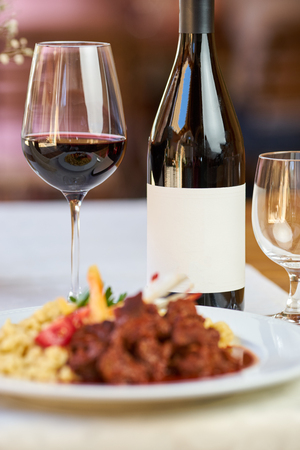 A bottle of wine and food in a restaurant