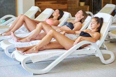 Three young woman relaxing in spa 스톡 콘텐츠