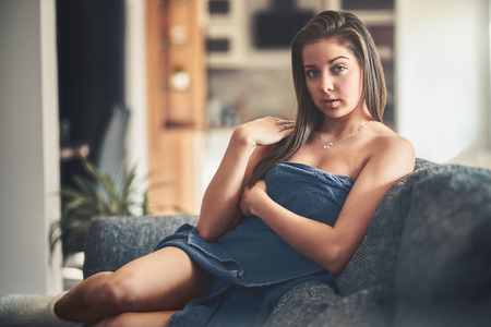 Beautiful and sexy young woman in towel at her home, with fine film grain effect