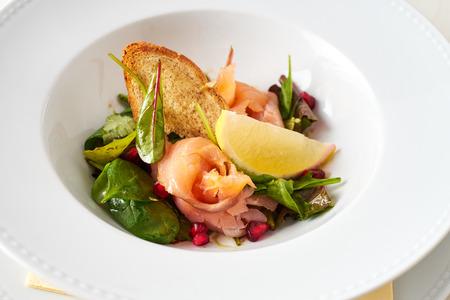 Smoked salmon with grana apple salad Standard-Bild