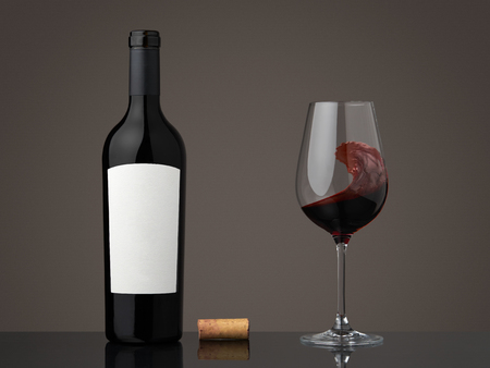 Wine bottle with wineglass. Red wine in a glass Archivio Fotografico