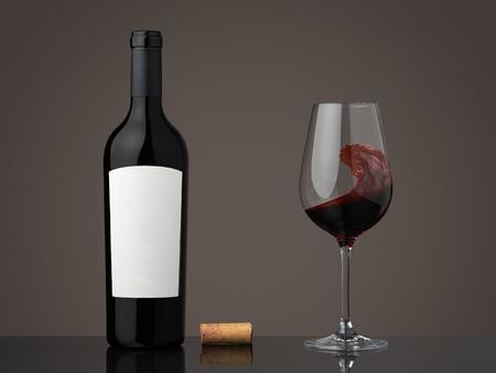 Wine bottle with wineglass. Red wine in a glass Standard-Bild
