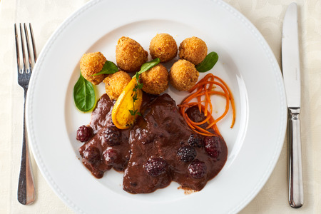 Roast boar with wine sauce and mulberry