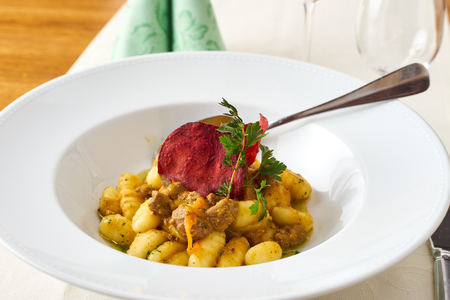 Pork Brasov with cooked potatoes and beetroot chips