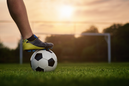 Soccer ball in the background with soccer ball in the background Archivio Fotografico - 99285563