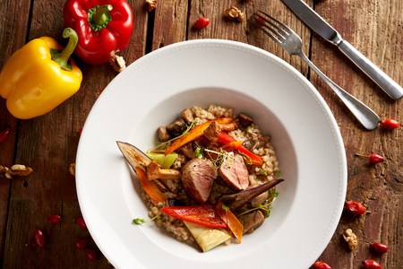 Sous Vide pork medallions with forest mushrooms and pearl barley risotto Archivio Fotografico