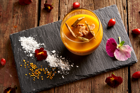 Mango Pudding with snack on old wood table