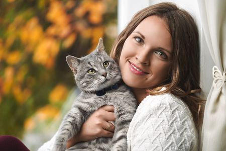 Young woman with his lovely cat