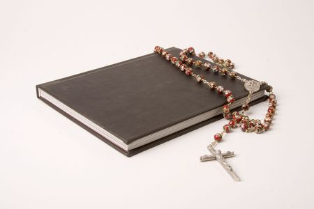 Black book and rosary Stock Photo - 2373522