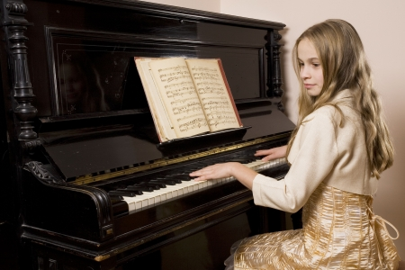 Little girl playing the piano photo