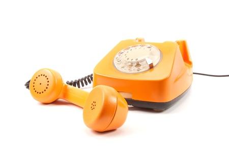 Orange retro telephone isolated on white