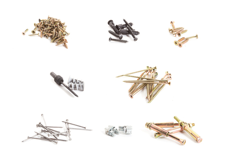 A collection of many metal screws isolated on a white background Stock Photo