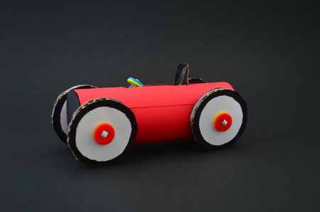 race car made of cardboard in a black background Stock Photo