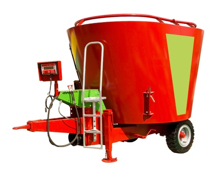 Een mixer-wagen, of een dieet voeder, is een specialist agrarische machine gebruikt voor het nauwkeurig wegen, mengen en distribueren van Total Mixed Rantsoen voor landbouwhuisdieren herkauwende dieren, met name runderen en meest, melkvee Stockfoto