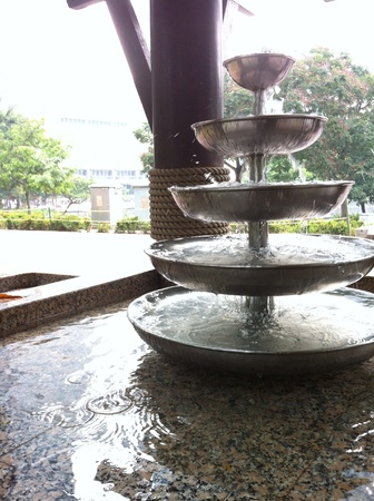 water feature: Good design elements of water feature with filtration that allow people to drink the water at the park.