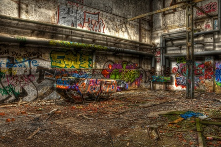 Broken car in an abandoned hall photo