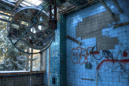 Broken operating theater in an old sanatorium photo
