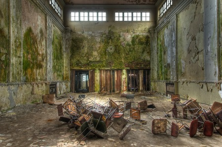 Big old hall with doors and chairs on the floor