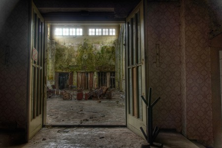 View of a large abandoned hall with chairs photo