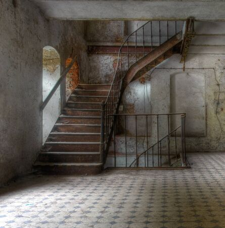 Old metal staircase in an abandoned factory photo