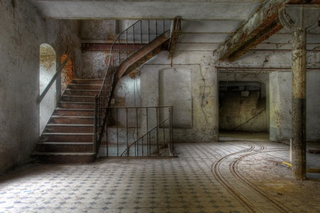 Old staircase in an abandoned factory and tracks