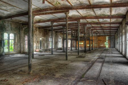 abandoned warehouse: Warehouse with rails in an abandoned factory Stock Photo
