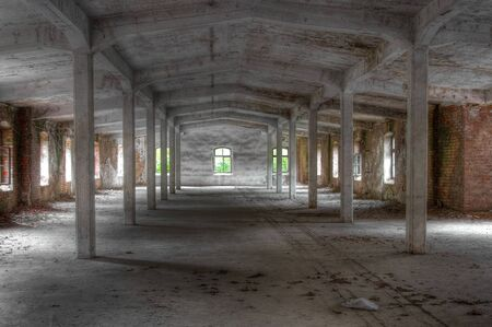 Long abandoned hall with white pillars