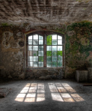 Double windows in an abandoned building Stock Photo