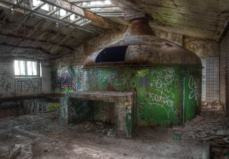 Large brewery tank in an abandoned brewery