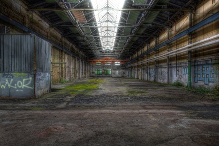 abandoned warehouse: Large abandoned warehouse with a shed