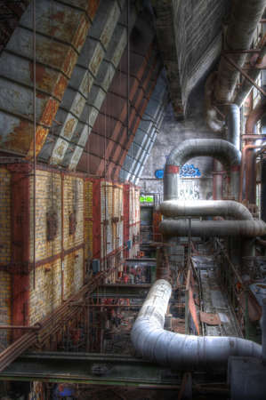 going places: Old furnaces with chimneys and old pipes
