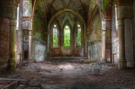 View through an abandoned church with large windows