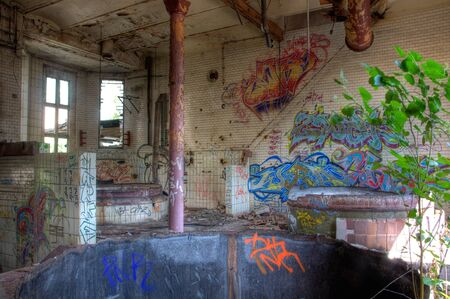 Old brew kettle in an abandoned brewery