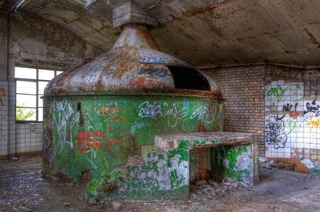 Old kettle for brewing beer in an abandoned brewery