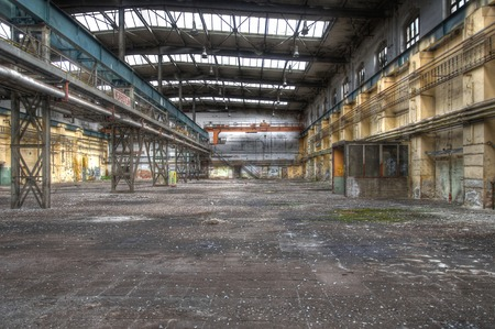 Large abandoned warehouse with an old crane